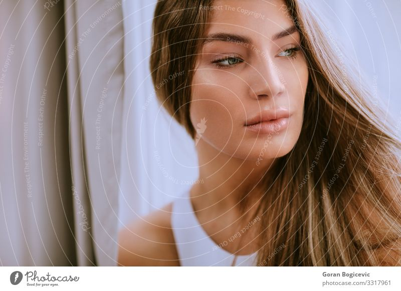 Pretty young long hair female brunette in front of the window Lifestyle Style Happy Beautiful Hair and hairstyles Skin Face Human being Young woman
