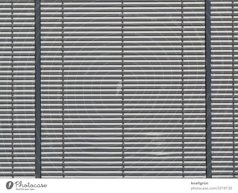 Close-up of a lamella facade made of metal Lamella facade Wall (building) Facade Pattern Metal level Across Silver Structures and shapes Line Exterior shot