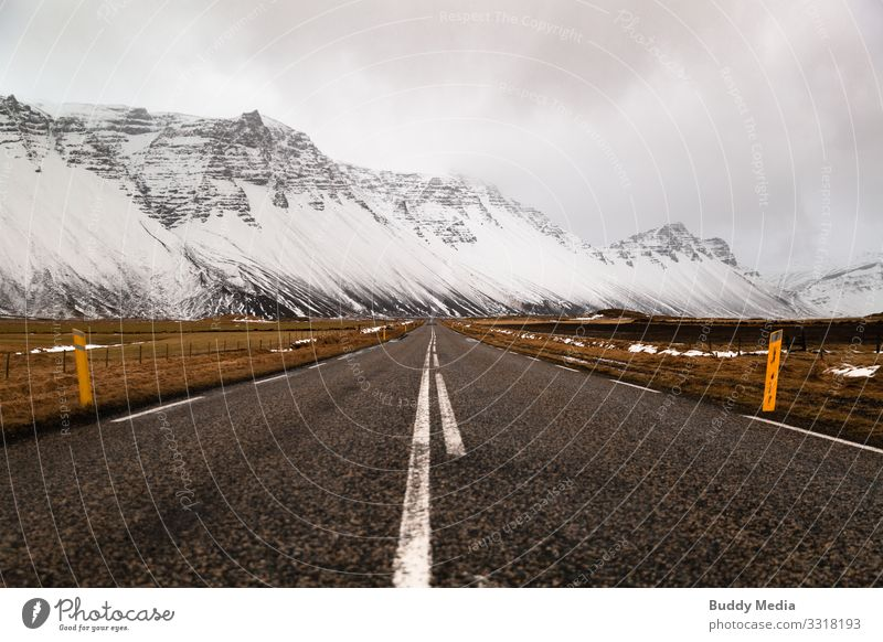 Street in the west of Iceland Sightseeing Expedition Winter Snow Mountain Landscape Earth Sand Sky Clouds Bad weather Grass Rock Glacier Deserted Discover