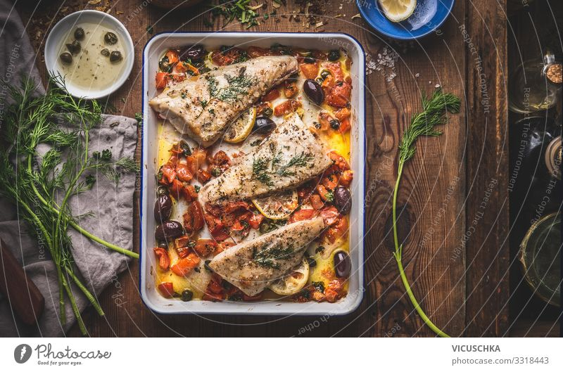 Delicious fish fillets in mediterranean sauce Food Fish Nutrition Diet Crockery Style Design Healthy Eating Living or residing Restaurant bass