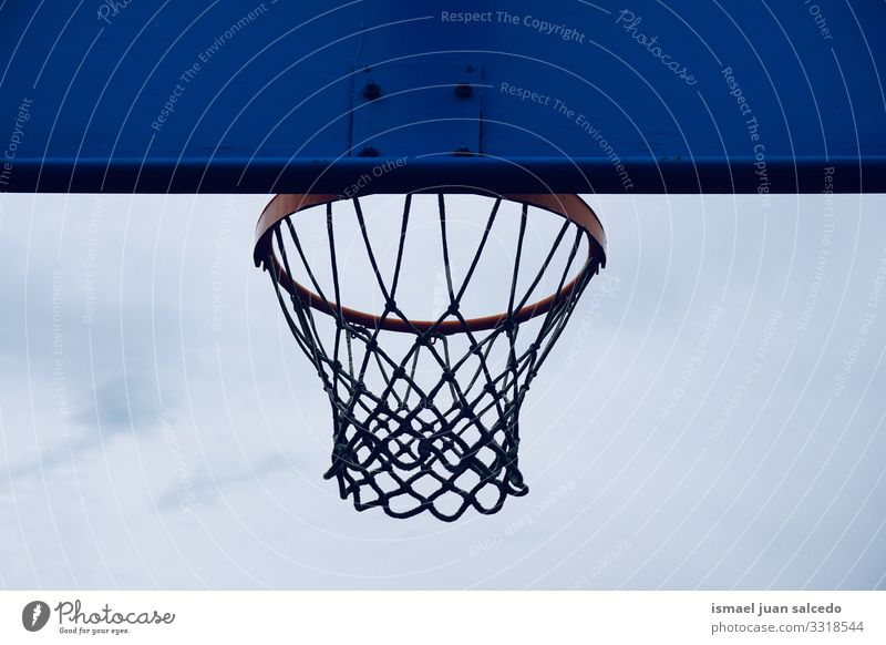 basketball hoop on the street, street basket in Bilbao city Spain sky blue silhouette circle chain metallic net sport sports equipment play playing playful old