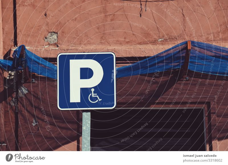 wheelchair traffic signal on the street in Bilbao city Spain symbol disabled disabled sign parking accessibility care road road sing asphalt handicapped icon