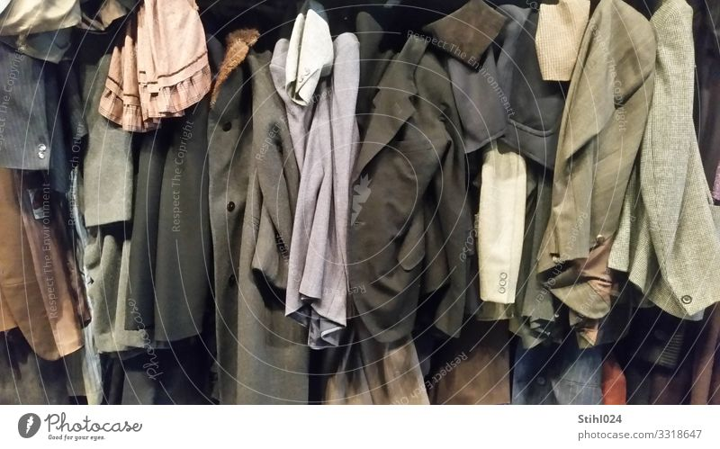 many old jackets hung up next to each other Clothing Dress Suit Jacket Coat outerwear Hang Old Elegant Hideous Blue Brown Gray Black Orderliness Modest Thrifty