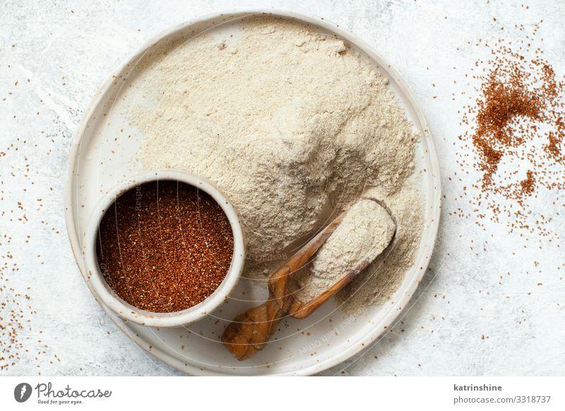 Teff flour and teff grain Vegetarian diet Diet Plate Bowl Spoon Wood Above Flour Ethiopian food african gluten free preudocereal Cooking healthy Heap