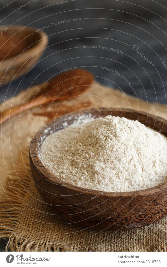 Teff flour in a bowl and teff grain with a spoon Vegetarian diet Diet Bowl Spoon Wood Healthy Tradition Flour Ethiopian food african gluten free preudocereal