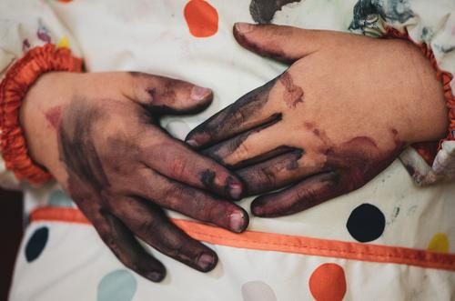 Painted hands lying on apron Human being Child Toddler Infancy by hand Fingers 1 1 - 3 years 3 - 8 years Touch To hold on Authentic Dirty Together Near
