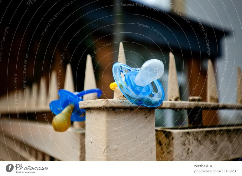 Two dummies Keep Baby Discovery site Find Real estate Child Kindergarten Toddler Soother suction cup Doomed Fence Border Boundary Deserted Copy Space