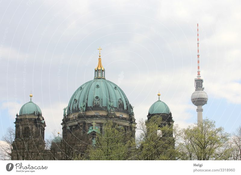 Berlin Cathedral and television tower against a cloudy sky Environment Nature Sky Clouds Tree Capital city Downtown Dome Manmade structures Building