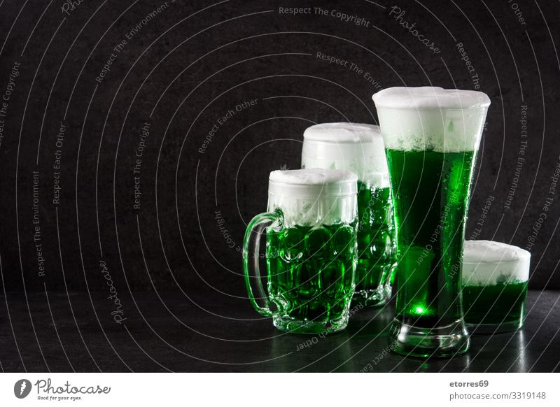 Traditional St Patrick's Day green beer on black background. saint patricks day Beer Green Beverage Drinking Alcoholic drinks Festive Vacation & Travel