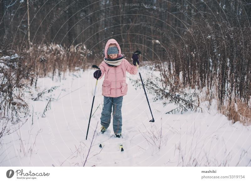 happy child girl skiing in winter snowy forest Child Vacation & Travel Youth (Young adults) Landscape Relaxation Joy Forest Winter Snow Sports Happy