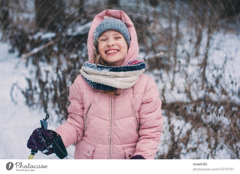 happy child girl skiing in winter snowy forest Joy Happy Relaxation Leisure and hobbies Vacation & Travel Adventure Winter Snow Sports Child