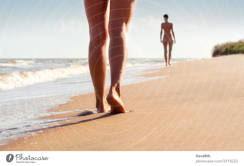 nude young girls walk on the beach in the waves of the surf Woman Sky Vacation & Travel Nature Naked Summer Landscape Ocean Beach Adults Warmth Coast Couple