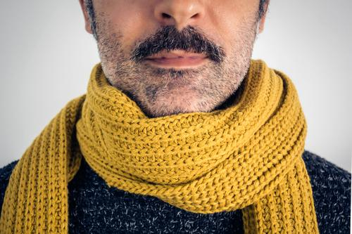 Close up of brown man with mustache and yellow scarf. Adults Beautiful Brown Cancer Casual clothes Caucasian Charming Close-up Common cold Cool (slang)