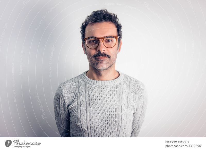 Man with mustache and glasses standing looking at camera. Adults Attractive Brown Cancer Casual clothes Caucasian Charming Self-confident Cool (slang)