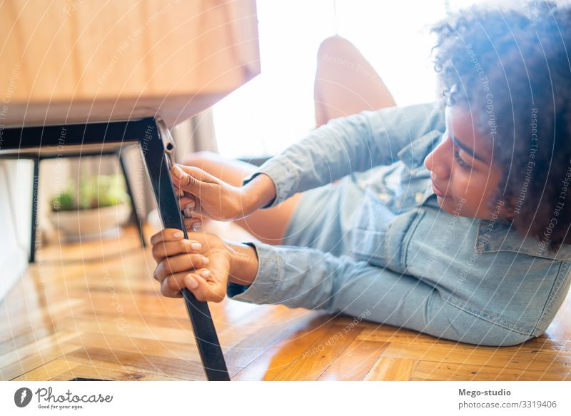 Afro woman repairing furniture at home. Woman Hand House (Residential Structure) Lifestyle Adults Work and employment Cleaning Furniture Home Tool Lady Repair
