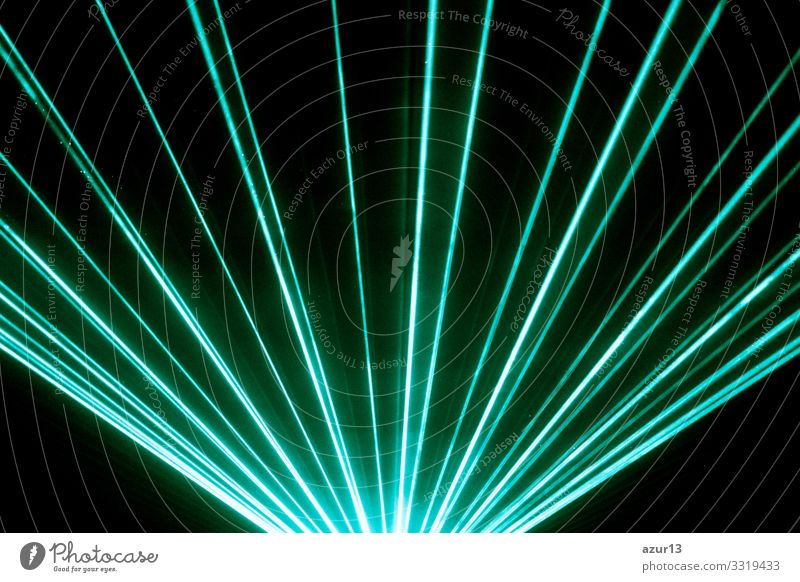 Turquoise laser show nightlife club stage shining sparkling rays New Years Eve luxury party event nightclub concert entertainment music festival light
