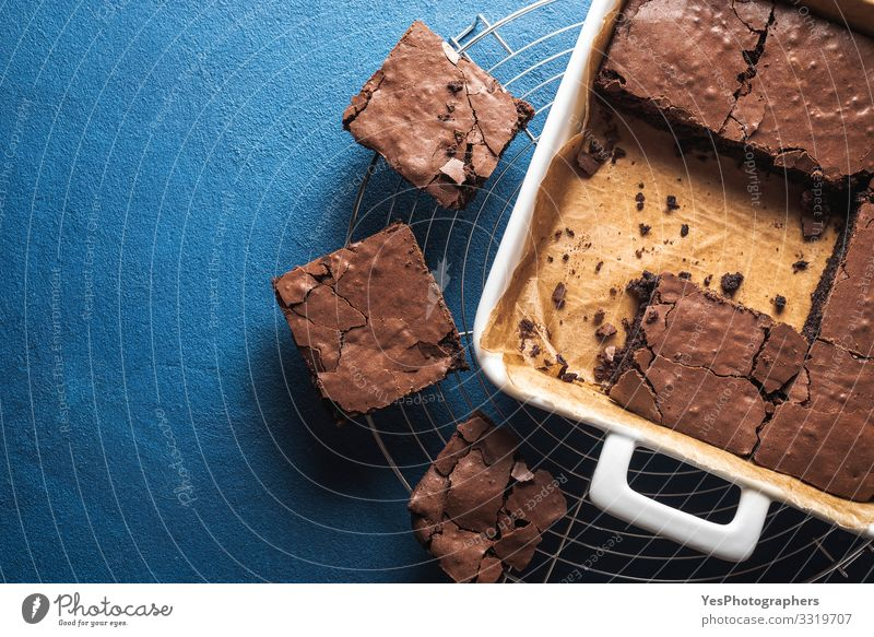 Brownies in a pan and on a cooling tray. Homemade brownies Food Cake Dessert Candy Chocolate Pan Delicious Sweet Blue above view american dessert Baked goods