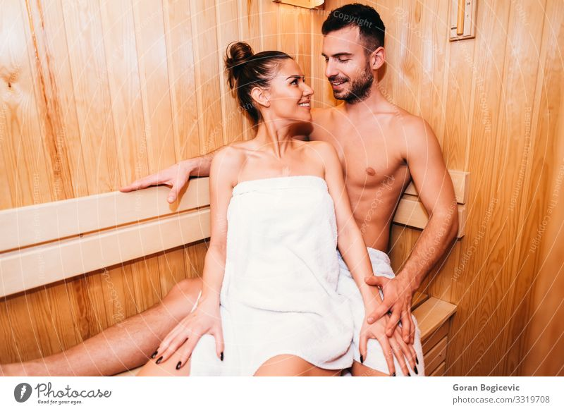 Young couple relaxing in the sauna Lifestyle Luxury Beautiful Body Skin Medical treatment Wellness Relaxation Spa Sauna Human being Young woman
