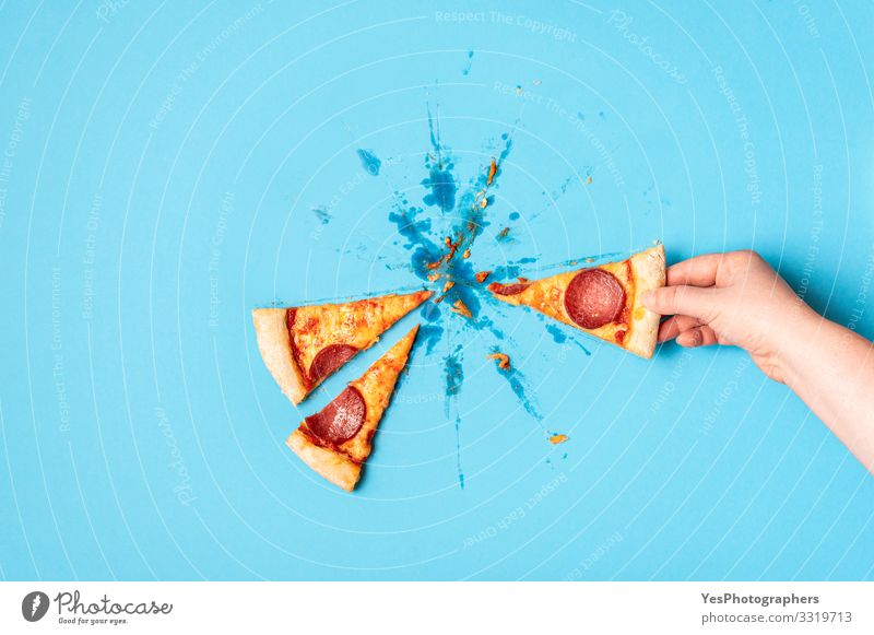 Grabbing slice of pizza. Taking pizza salami. Pizza pepperoni Dough Baked goods Lunch Dinner Fast food Finger food Italian Food Hand Delicious Blue Yellow