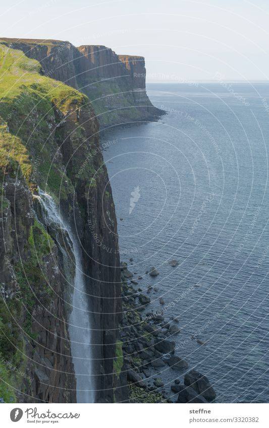 Cliff at the sea with waterfall steep coast Ocean Waterfall Scotland Isle of Skye Nature Landscape Vacation mood