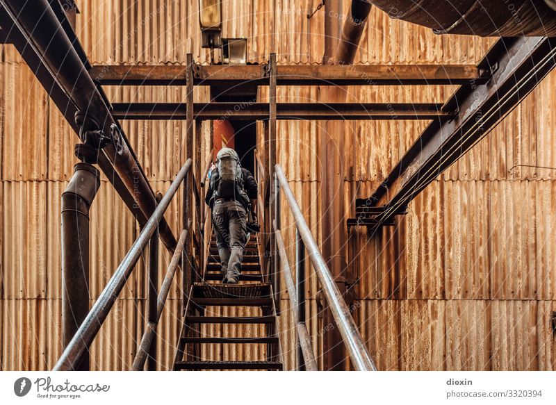 Unknown territories Adventure Human being Masculine Young man Youth (Young adults) 1 30 - 45 years Adults Industrial plant Ruin Steel factory Stairs Facade