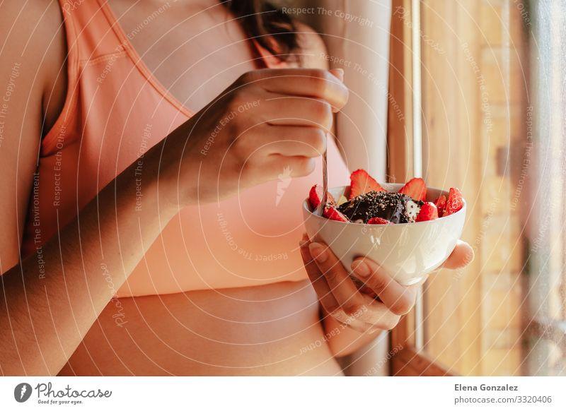 young woman with sports bra eating breakfast bowl Food Yoghurt Fruit Apple Grain Dessert Nutrition Eating Breakfast Organic produce Vegetarian diet Diet Bowl