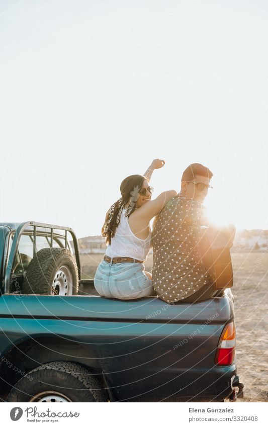 Young travelers having fun with the guitar on top of car Lifestyle Happy Beautiful Vacation & Travel Tourism Summer Sun Woman Adults Man Couple Guitar Landscape