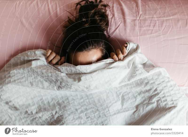 Playful young woman hiding face under blanket Woman Relaxation Face Adults Emotions Fear Smiling Sleep Long Stress Shame Lie (Untruth) Duvet Expression
