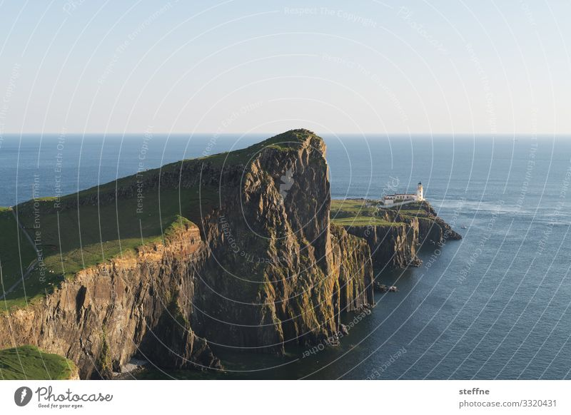 Cliff at the sea with lighthouse steep coast Ocean Scotland Isle of Skye Nature Landscape Vacation mood Lighthouse Exterior shot Travel photography Island