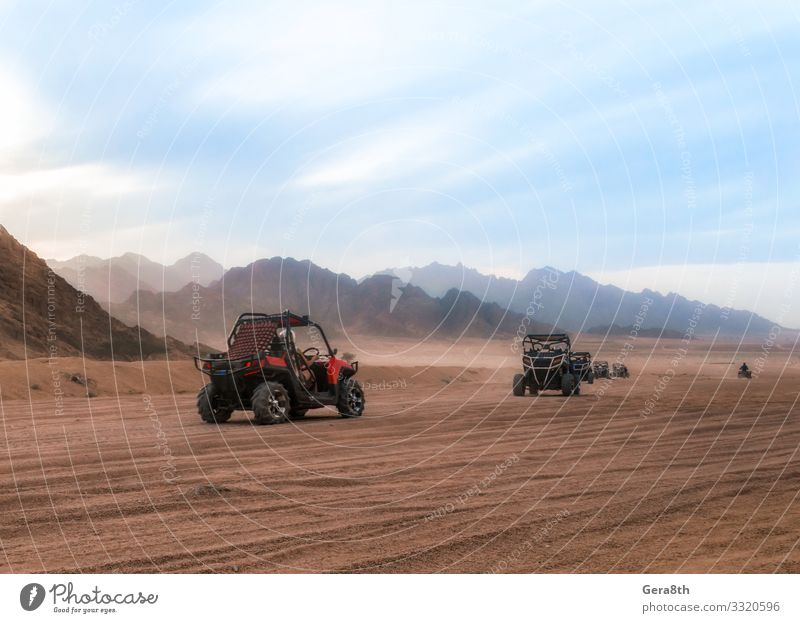cars buggy with tourists on a trip to the desert in Egypt Vacation & Travel Tourism Trip Adventure Mountain Group Nature Landscape Sand Sky Clouds Climate Rock