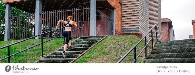 Female athlete climbing stairs outdoors Woman Human being Adults Sports Copy Space Action Fitness Internet Climbing Thin Top Mountaineering Sneakers Horizontal