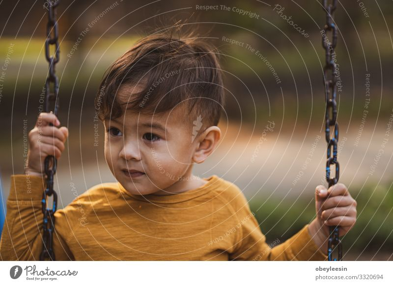 happy young boy playing outdoors in the park Human being Child Boy (child) 1 1 - 3 years Toddler Going Good Funny Colour photo Multicoloured Close-up Detail