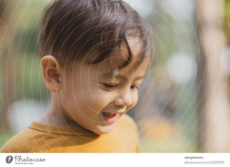 happy young boy playing outdoors in the park Lifestyle Joy Happy Leisure and hobbies Playing Child Boy (child) Man Adults Family & Relations Friendship Infancy