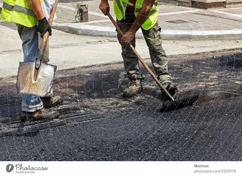 Workers using asphalt paver tools during road construction. Work and employment Industry Machinery Building Transport Street Highway Vehicle New Maintenance