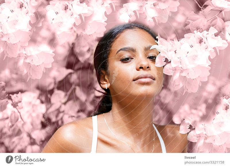 beautiful young woman among pink flowers Lifestyle Happy Island Garden Human being Feminine Young woman Youth (Young adults) Woman Adults Skin Head Face Eyes