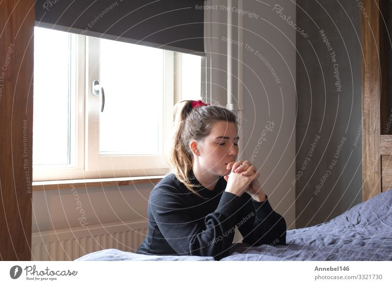 Religious Praying Woman is praying at her bed Beautiful Face Meditation Human being Adults Hand Church Old Love Sadness Dark Black White Hope Distress Peace