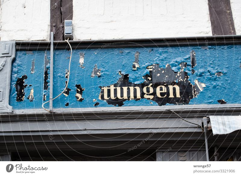 Old | mysterious advertisement above a shop topic day publicity Advertising shank Store premises puzzling indistinct built Facade Exterior shot Wall (building)