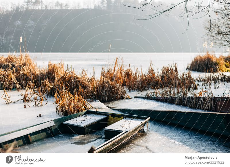 Boats in a frozen lake in winter time Nature Landscape Water Sunlight Winter Weather Ice Frost Lakeside River bank Pond Fishing boat Freeze Cold Moody Peaceful