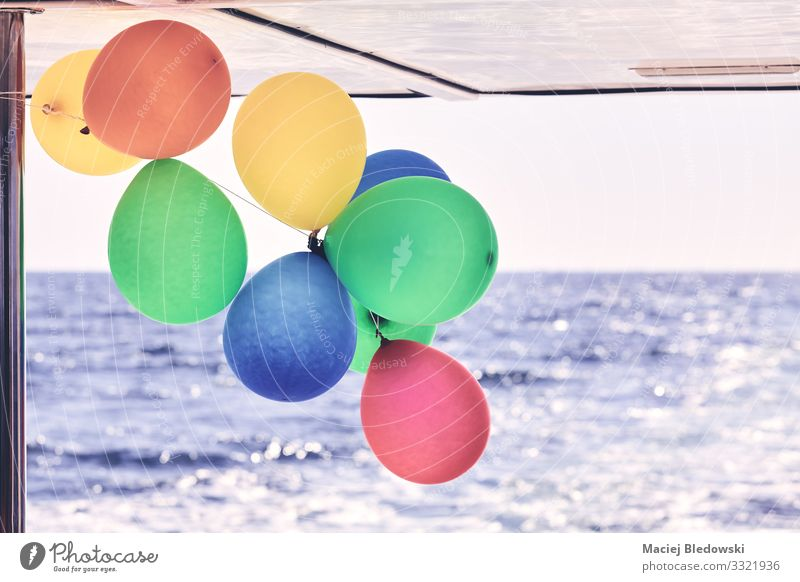 Colorful party balloons on a boat. Luxury Joy Happy Leisure and hobbies Vacation & Travel Trip Cruise Summer Summer vacation Ocean Waves Decoration
