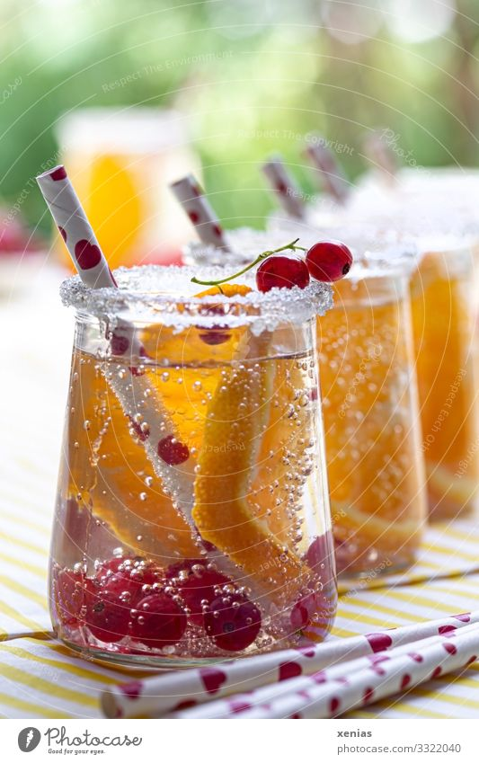 Detox drinks with orange and currant Fruit Orange Redcurrant Sugar Beverage Cold drink Drinking water Glass Straw Summer Living or residing Garden