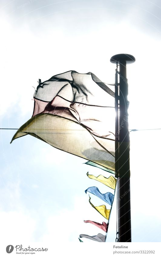 flag in the wind Sky Clouds Summer Beautiful weather Wind Bright Blue Yellow Red Black White Flag Flagpole Rope Blow pennant chain Colour photo Multicoloured