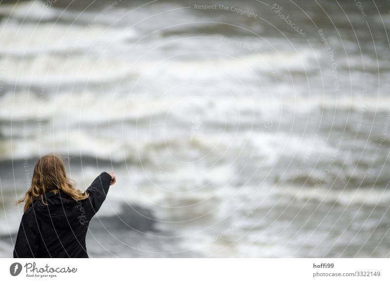 Out there. Beach Island Waves Young woman Youth (Young adults) 1 Human being 18 - 30 years Adults Water Bad weather Wind Gale Rain North Sea Wall (barrier)