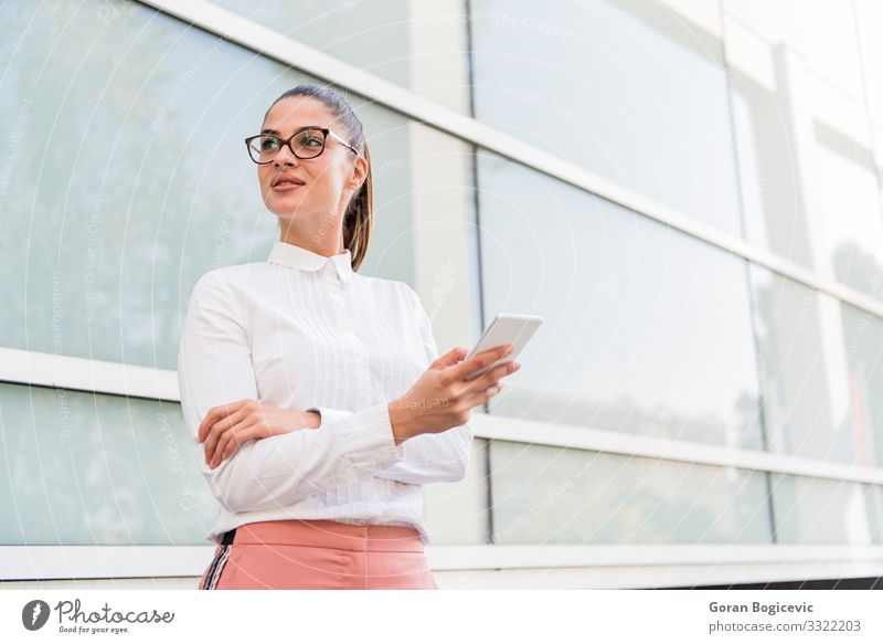 Caucasian businesswoman using smartphone outdoor Lifestyle Beautiful Relaxation Work and employment Business Telephone PDA Technology Internet Human being