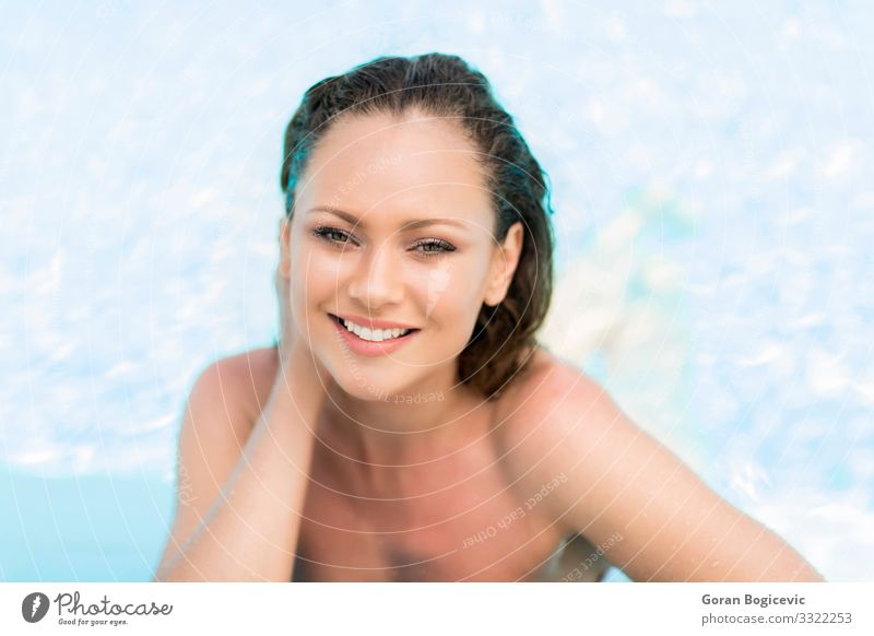 Young woman in the pool Relaxation Calm Swimming pool Leisure and hobbies Summer Sun Human being Youth (Young adults) Woman Adults 1 18 - 30 years Bikini Blonde