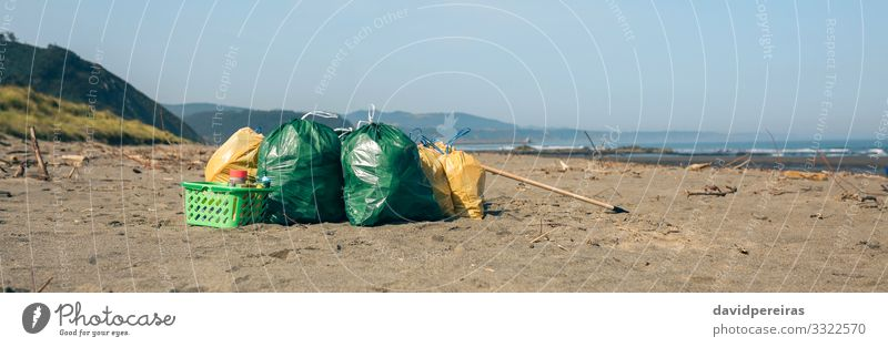 Garbage bags and utensils on the beach Beach Internet Environment Nature Landscape Sand Coast Clean Disaster Teamwork garbage bags after Trash collected