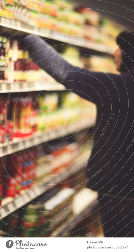A woman reaches for a product in a grocery store Store premises shopping mall Shopping Woman Deep depth of field Grasp Product Food Shelves Merchant purchasing
