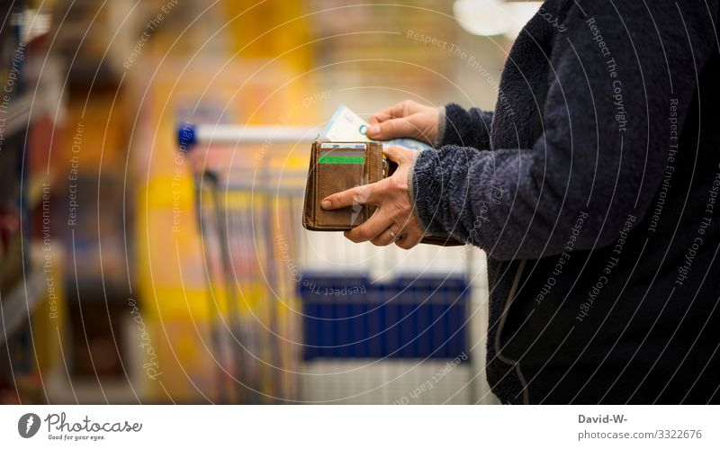 Woman counts her money in landing / business Shopping Trolley Food Supermarket Colour photo Consumption Store premises Human being consumer by hand purchasing