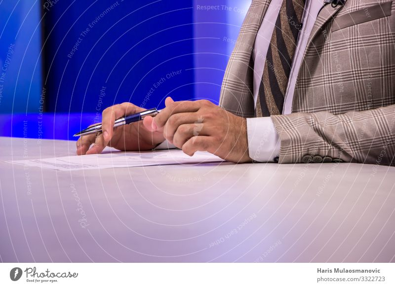 Hands man writing on paper business TV set Human being 1 18 - 30 years Youth (Young adults) Adults Media Television Suit Tie Shirt Sit Trade Write Paper Pen