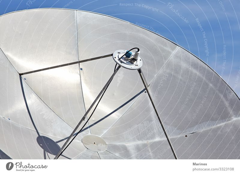 Closeup view of satellite dish.Communications. Telecommunications Telephone Technology Internet Media Television Earth Sky Antenna Telescope Communicate