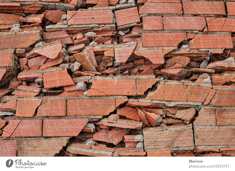 Broken brick wall as backgound. Building Architecture Stone Concrete Brick Old Dirty Red White Destruction broken Hole background Consistency Crack & Rip & Tear